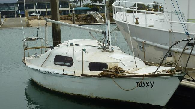 """The """"almost derelict"""" yacht sits in Manly Boat Harbour after its young owner became stranded in Moreton Bay."""