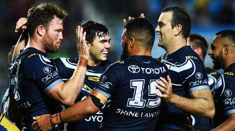The North Queensland Cowboys celebrate a try. Picture: Zak Simmonds