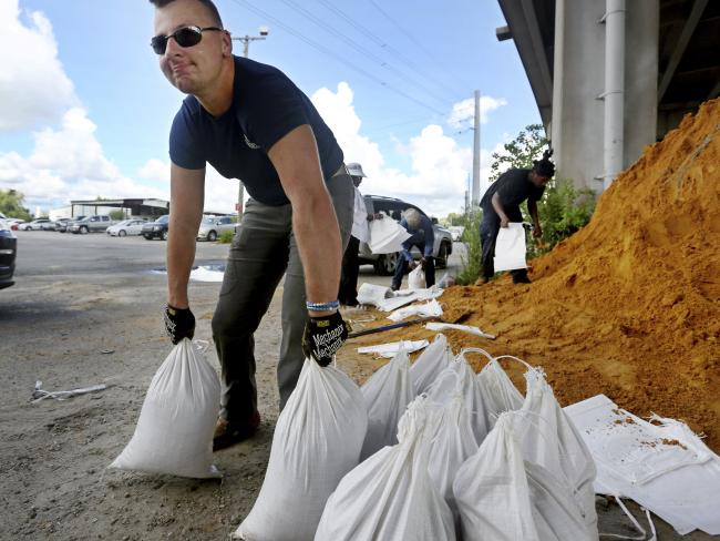 Kevin Orth loads sandbags into cars in Charleston, SC, as he helps residents prepare for Hurricane Florence. Picture: Grace Beahm Alford/AP