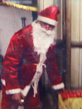 Charlie Colt dressed as Santa on the family farm.