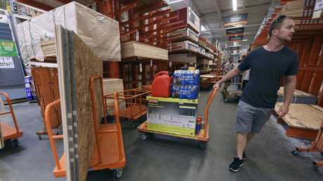 Americans buy supplies at The Home Depot before the hurricane hits.