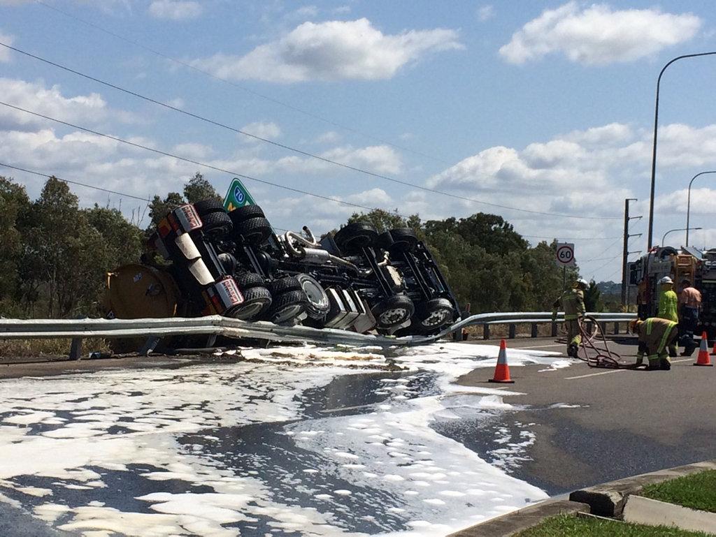 Truck rollover on motorway