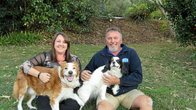 Danielle with husband Darren with their two dogs at their Black Mountain home
