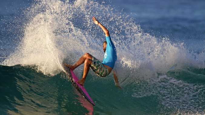 RIPPING: Josh Constable expresses himself out in the surf.