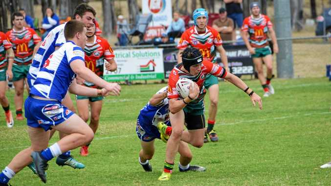 GRAND CHAMPIONS: The under 16 Bulldogs fight it out for the premiership in Nanango.
