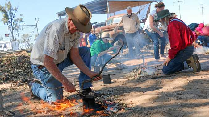 BUSH LIFE: David McDonald and Howard Hawke boiling their billies on Sunday at the Miles Historical Village as part of the Back to the Bush Festival.