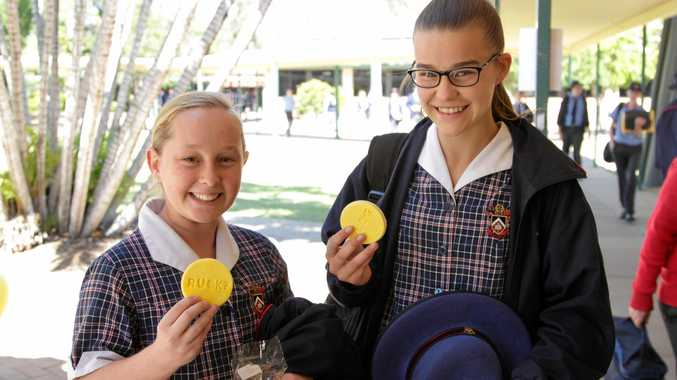 RUOK?: Year 8 Shalom College students Olivia Keech and Alani Morley support fundraising efforts by purchasing cookies and (above) the message spelled out by students.
