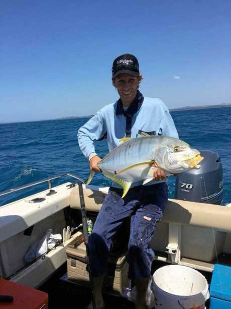 Matthew Dillon with a golden trevally.