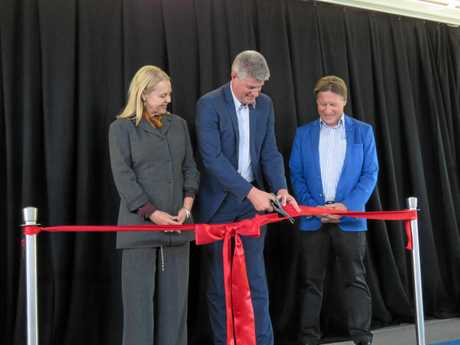 Stirling Hinchliffe cuts the opening ribbon, while Sandy Bolton and Tony Wellington look on.
