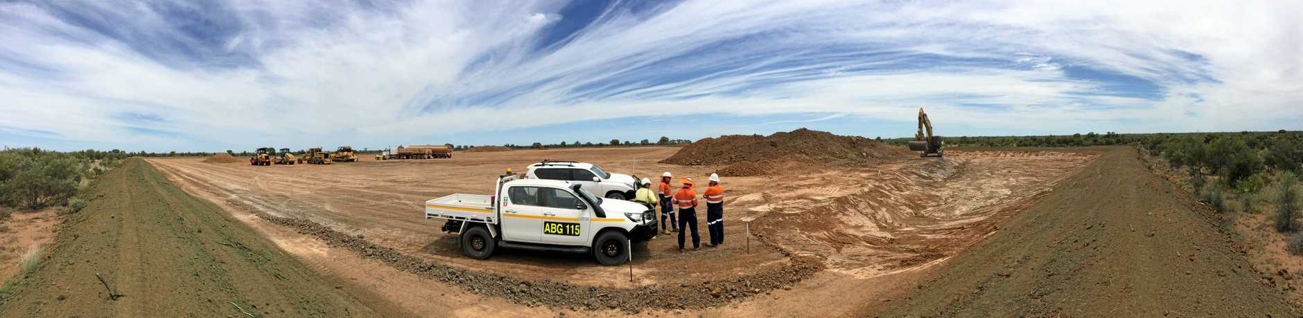 Temporary Rail Camp Construction - Adani and contractor personnel overseeing the earthworks of the Temporary Camp hardstand including sediment basin excavation