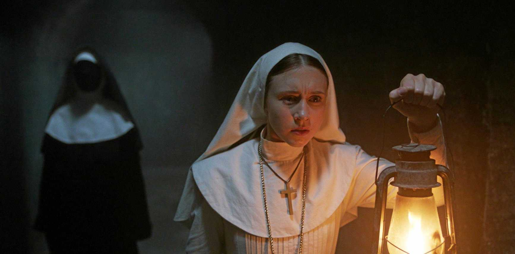 BEHIND YOU: Taissa Farmiga's Sister Irene is stalked by the supernatural in a scene from  The Nun .