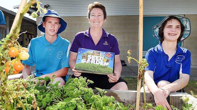 GOOD FOOD: Students at Hervey Bay Special School Jeremiah and Shanya with teacher Kathleen Heath at their vegie garden.