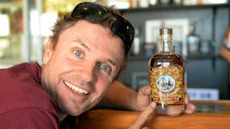 James Dezarnaulds aka Jimbo Bazoobi at The Saleyards Distillery with a bottle of Gary the Goat rum.