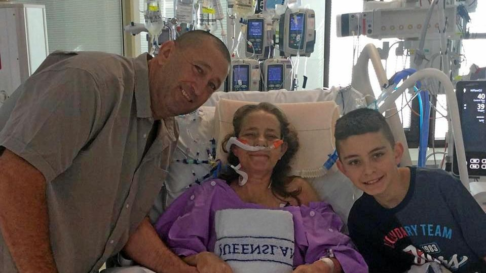 IN RECOVERY: Alison Battistuzzi has had a successful double lung transplant. Pictured at Prince Charles Hospital in Brisbane with husband Andrew and son Dominic Battistuzzi.