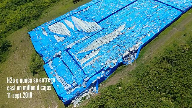 A photo of a stockpile of bottled water that was never delivered to hurricane victims. Picture: Abdiel Santana