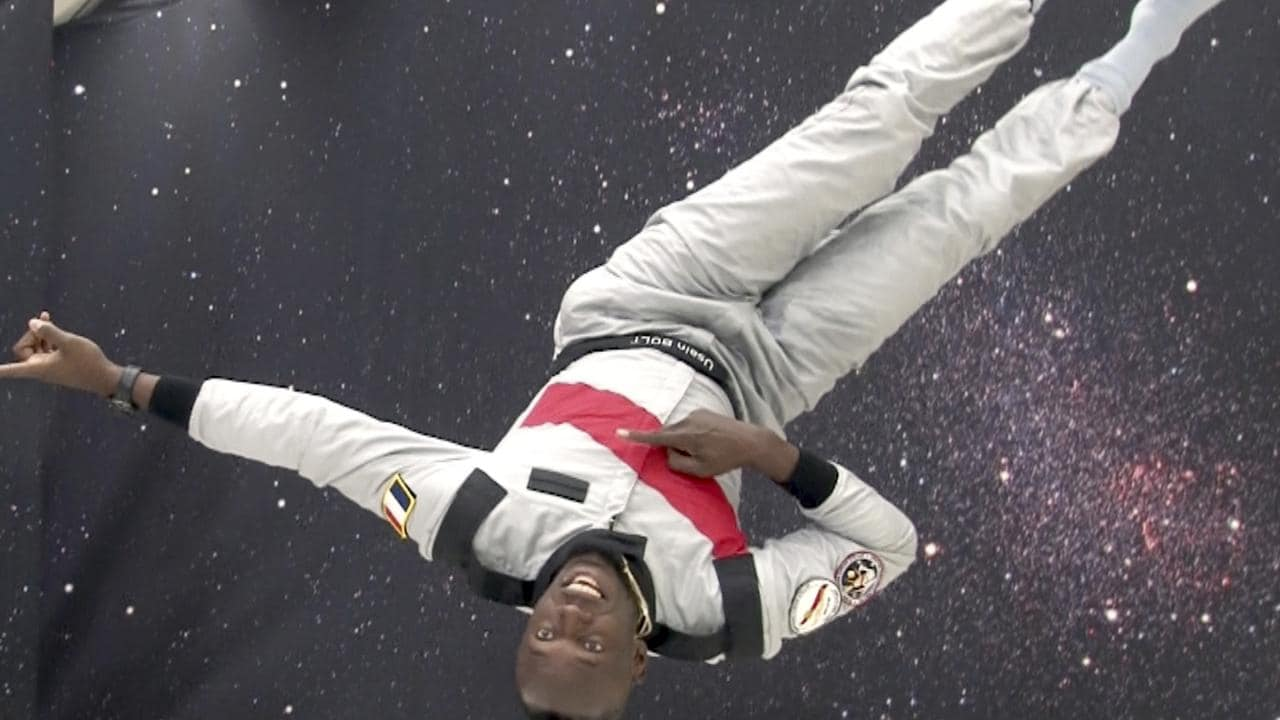 Usain Bolt enjoys a zero-gravity flight over France.