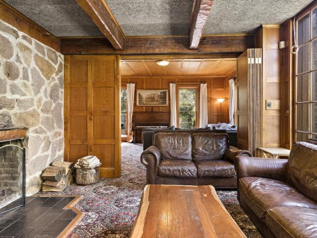 Adjoining loungerooms are connected through bi-fold timber doors.