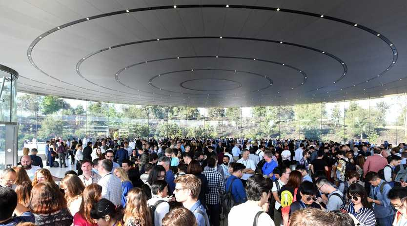 A crowd of people wait to enter the Steve Jobs Theater on Apple' Cupertino campus. Picture: AFP PHOTO / Josh Edelson