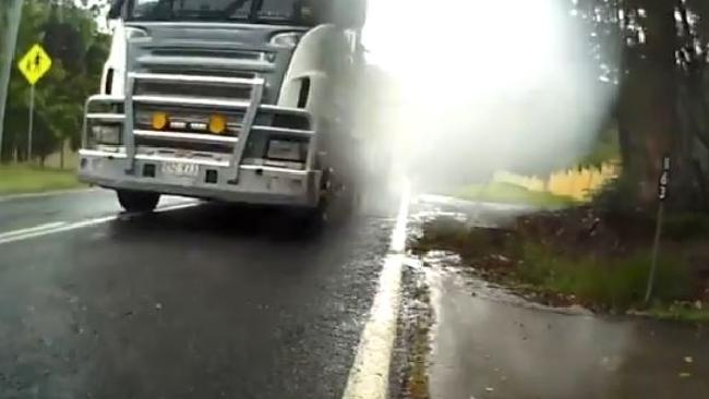 The moment before the truck nearly hits the cyclist.