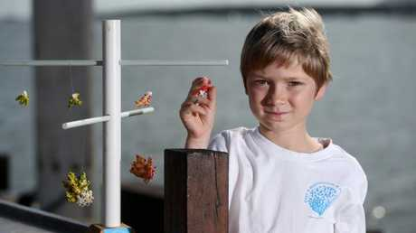 Eight-year-old son Khai and his father Gary McKenna have launch the Coral Crusaders campaign to expand Australia's first ocean-based nurseries on the Great Barrier Reef through the adoption of coral. PICTURE: STEWART MCLEAN