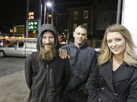 Johnny Bobbitt Jr., left, Kate McClure, right, and McClure's boyfriend Mark D'Amico pose at a Citgo station in Philadelphia. Picture: Elizabeth Robertson/The Philadelphia Inquirer via AP