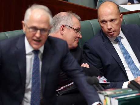 Malcolm Turnbull when he was PM as Scott Morrison chats with Peter Dutton during Question Time. Picture Gary Ramage