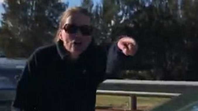 Shocking footage shows an altercation between two motorists that brought traffic to a standstill in Canberra.