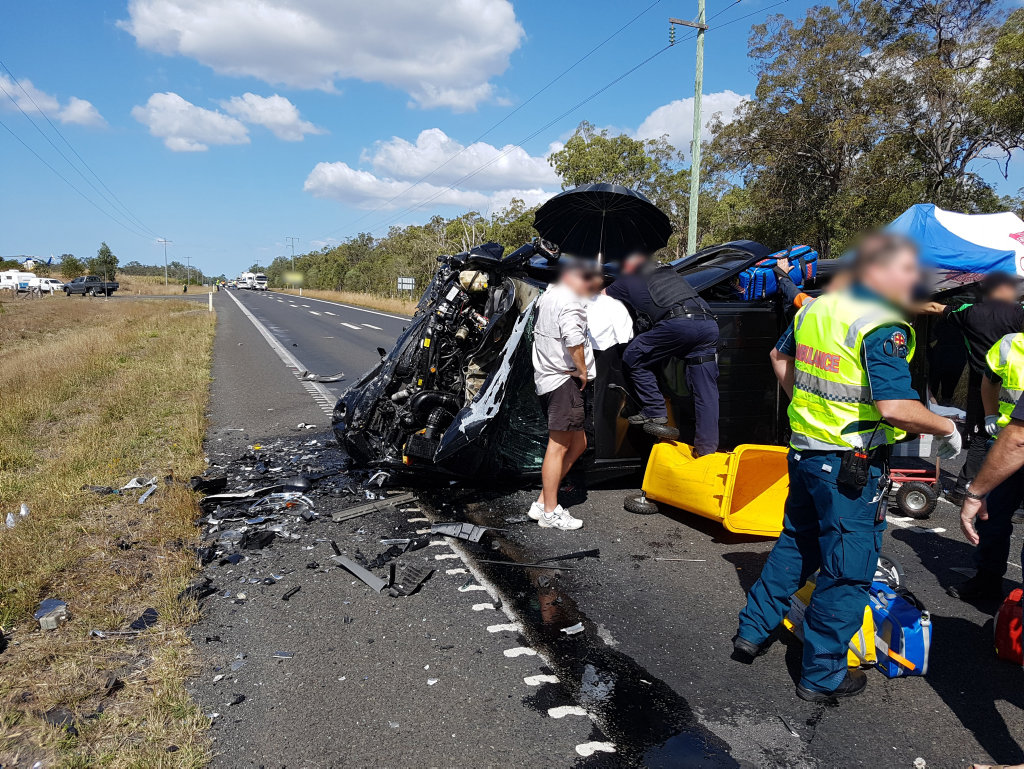 HORROR FATAL: Two people, including an eight-year-old girl, died in a fatal crash on the Bruce Hwy, south of Childers today.