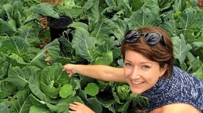 GETTING OUTDOORS: Educator Kellie Galletly encourages outdoor play.