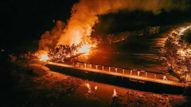 SMOKE ON THE WATER: A large blaze light up the banks of the Balonne River in St George Thursday night.
