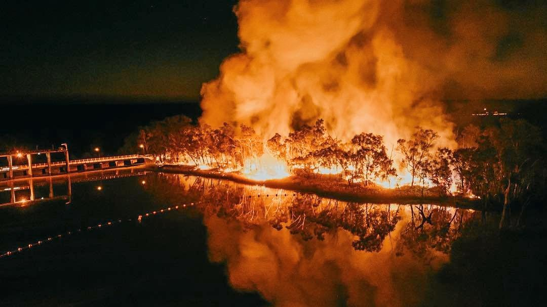 SMOKE ON THE WATER: A large blaze lights up the banks of the Balonne River in St George last night.