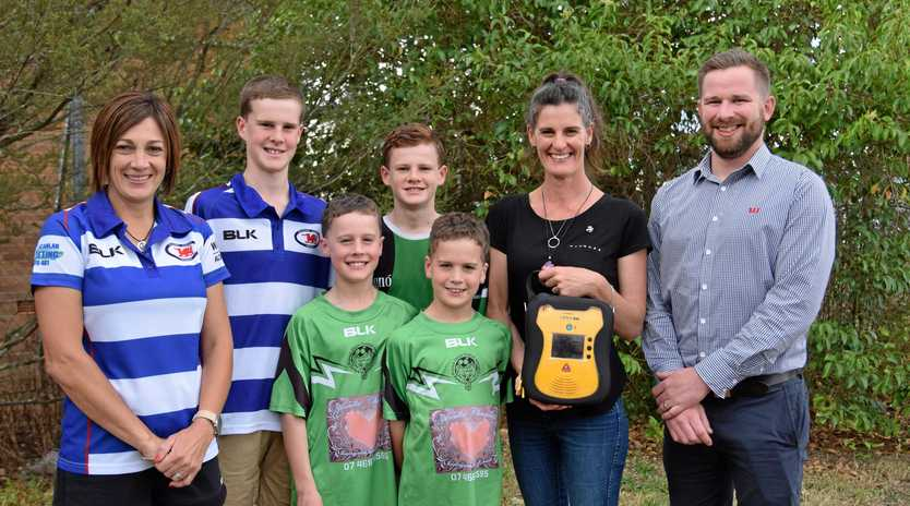 Collegians Junior Rugby League President Deb Scanlan, Joe, Beau, Noah, William and Jenny Thornton with Westpac branch manager Kim McGregor.
