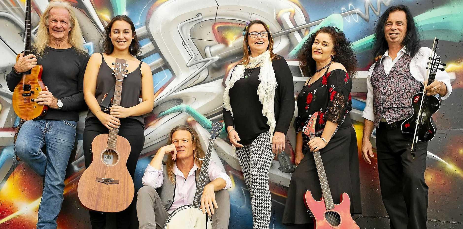MOO FEST: Musicians Ray Cat, Natasha Bitancurt, Chris Eaton, Andrea Deeley and Paul Robinson with organiser of Moo Fest, Joanne Mitchell.