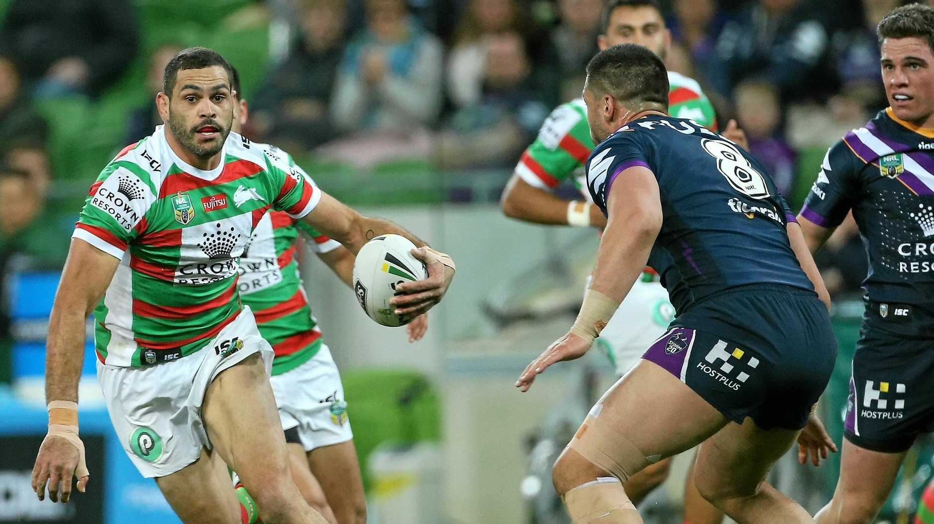 Greg Inglis of the Rabbitohs under pressure from Jesse Bromwich of the Storm during the Qualifying Final between the Melbourne Storm and the South Sydney Rabbitohs in Week 1 of the NRL Finals Series at AAMI Park in Melbourne, Friday, September 7, 2018. (AAP Image/Hamish Blair) NO ARCHIVING, EDITORIAL USE ONLY