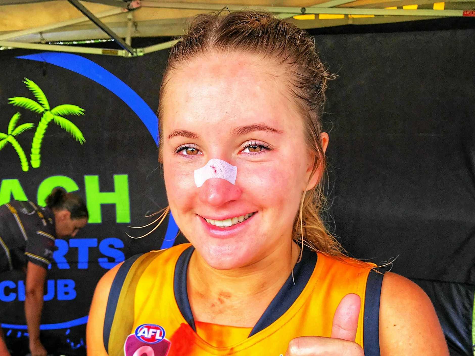 SORE BUT STILL SMILING: Tweed Coast Tiger Ellie Pritchard enjoying a well-earned post match beverage.