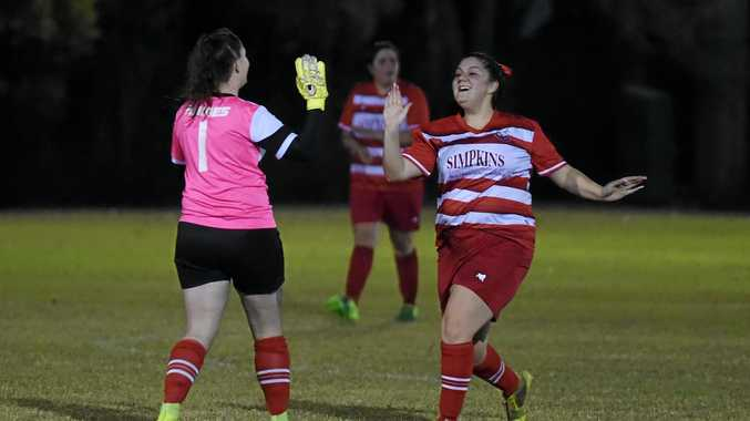 GRAND FINAL DAY: Tinana keeper Jess Raines and Shanice Ivey celebrate a goal earlier this season.