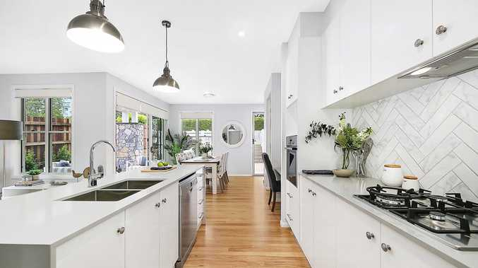 MAGNIFICENT KITCHEN: Buyers will love the stunning Caesarstone kitchen with its quality Bosch gas appliances.