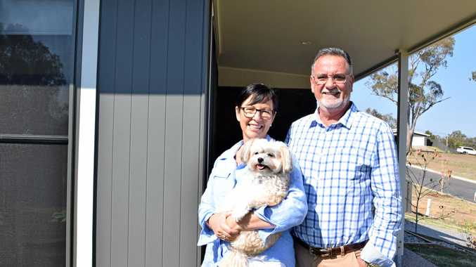 Barry and Julie Pickering with their dog Chicho. The family lost their home to Cyclone Debbie but a still reckon property is a solid investment. They're on a mission to get more young people into the property market.