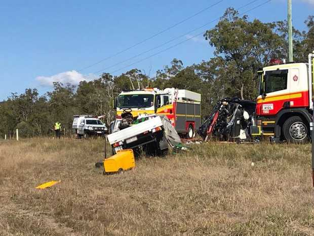 An eight-year-old girl and a man have died in a horror crash on the Bruce Hwy this afternoon