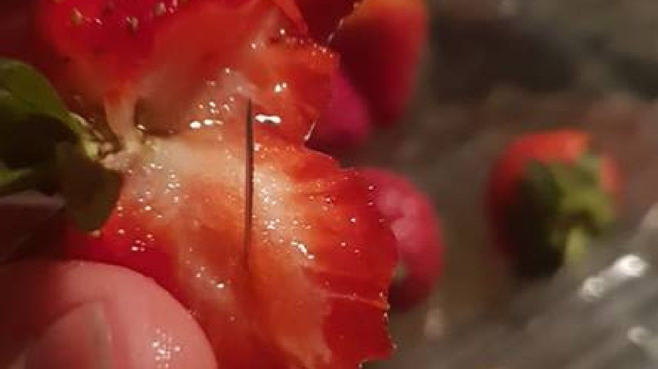 Pins found inside strawberries. Picture: Chantal Faugeras/Facebook