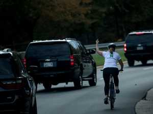 Cyclist who flipped Trump the bird is back