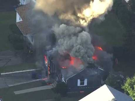 Firefighters battle a raging house fire in Lawrence, Mass, a suburb of Boston. Picture: WCVB