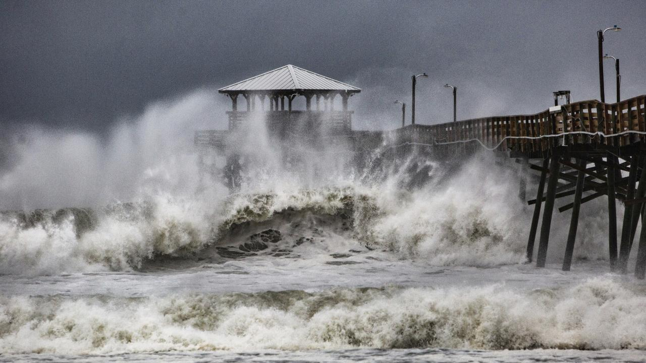 Waves slam the Oceana Pier & Pier House Restaurant in Atlantic Beach, North Carolina.