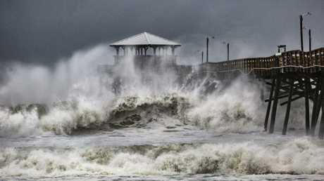 Waves slam the Oceana Pier & Pier House Restaurant in Atlantic Beach, North Carolina.