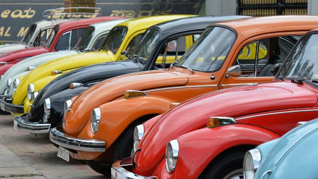 Vintage Volkswagen Beetle cars are parked in a row. Picture: AFP