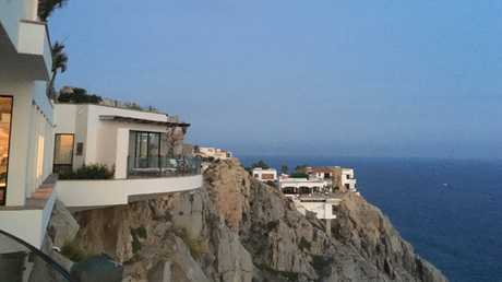 The mansion was perched on the edge of the Pacific Ocean.
