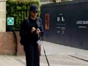 Was Meghan picking up dog poo?