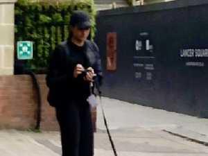 Was Meghan picking up dog poo?