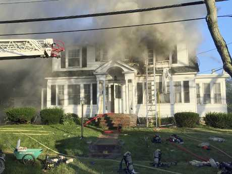 Firefighters battle a house fire on Herrick Road in North Andover. Picture: AP