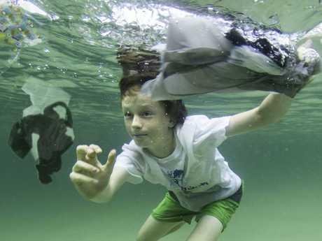 Arlian Ecker aka the Plastic Free Boy with rubbish in the ocean.